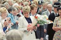 <p>Diana chose a classic striped blazer for a flower-filled walkabout in Sheffield in July 1991.<br></p>