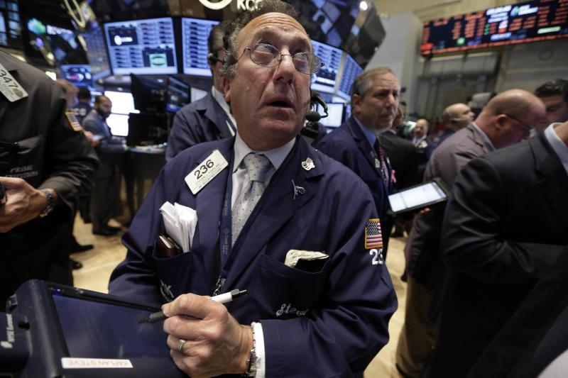 Trader Steven Kaplan works on the floor of the New York Stock Exchange Thursday, Oct. 31, 2013. Stocks edged lower in early trading on Wall Street Thursday, paring the market's big gain for October. (AP Photo/Richard Drew)