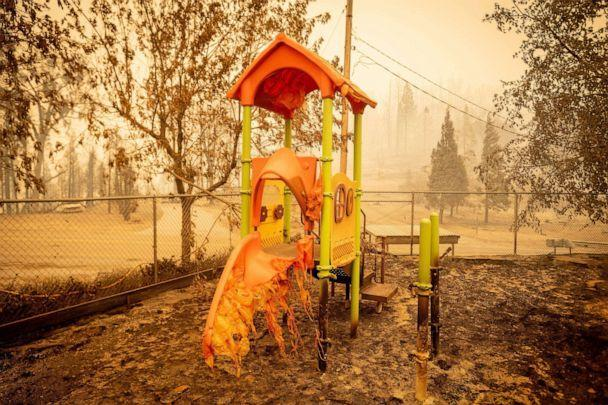 PHOTO: A melted slide smolders as a playground continues to burn at Pine Ridge school during the Creek fire in an unincorporated area of Fresno County, Calif., Sept. 08, 2020. (Josh Edelson/AFP via Getty Images, FILE)