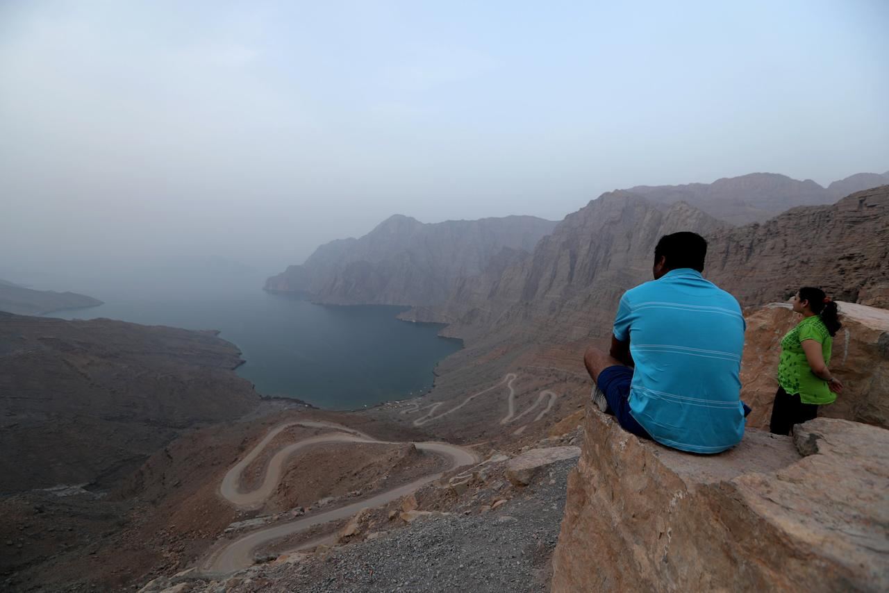 Tourists enjoy the view from Khor Najd Mountain in Musandam province, Oman, July 20, 2018. Picture taken on July 20, 2018. REUTERS/Hamad I Mohammed