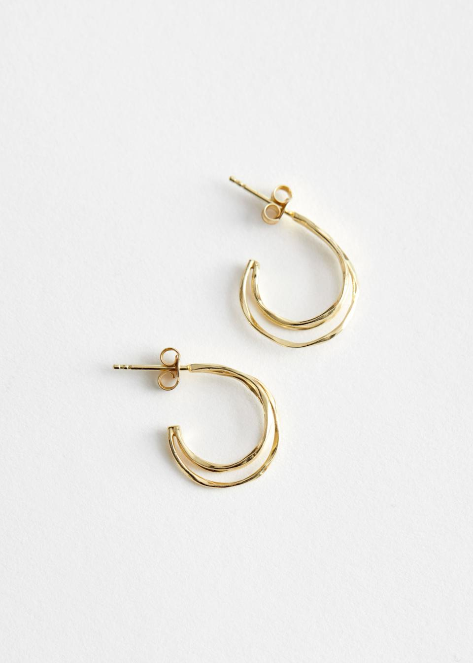 "<br><br><strong>& Other Stories</strong> Sterling Silver Twisted Hoop Earrings, $, available at <a href=""https://go.skimresources.com/?id=30283X879131&url=https%3A%2F%2Fwww.stories.com%2Fen_usd%2Fjewellery%2Fearrings%2Fhoops%2Fproduct.sterling-silver-twisted-hoop-earrings-gold.0842789001.html"" rel=""nofollow noopener"" target=""_blank"" data-ylk=""slk:& Other Stories"" class=""link rapid-noclick-resp"">& Other Stories</a>"