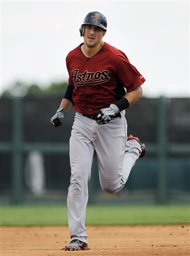 Houston Astros' Jason Castro rounds the bases after hitting a solo home run against the Detroit Tigers in the third inning during a spring training baseball game in Lakeland, Fla., Sunday, April 1, 2012. (AP Photo/Paul Sancya)