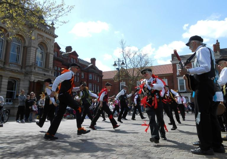 Morris dancers perform in the main square of the market town of Retford, Nottinghamshire on April 23, 2017