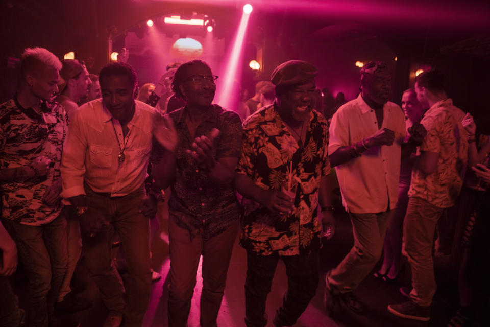 """This image released by Netflix shows, from second left, Norm Lewis, Clarke Peters Isiah Whitlock Jr., and Delroy Lindo in a scene from """"Da 5 Bloods,"""" named one of the top 10 films of the year by The American Film Institute. (David Lee/Netflix via AP)"""