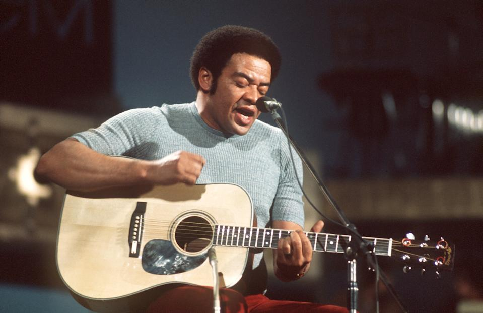 The American singer, guitarist and songwriter Bill Withers on stage at Music Festival in Cannes in 1973. The artist was born in Slab Fork, West Virginia, on 4th July 1938.   usage worldwide (Photo by Goebel/picture alliance via Getty Images)