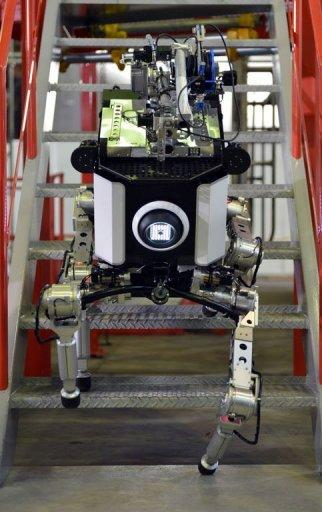 Toshiba's four-legged robot climbs steps during a demonstration at Toshiba's technical center in Yokohama, suburban Tokyo. Toshiba engineer Goro Yanase said the as-yet unnamed robot could be upgraded to carry more than 80 kilograms, climb ladders and step over obstacles up to 50 centimetres (20 inches) high