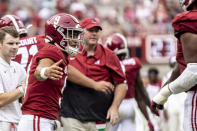 Alabama quarterback Bryce Young (9) welcomes in his teammates after an extra point during the first half of an NCAA college football game against Mississippi, Saturday, Oct. 2, 2021, in Tuscaloosa, Ala. (AP Photo/Vasha Hunt)