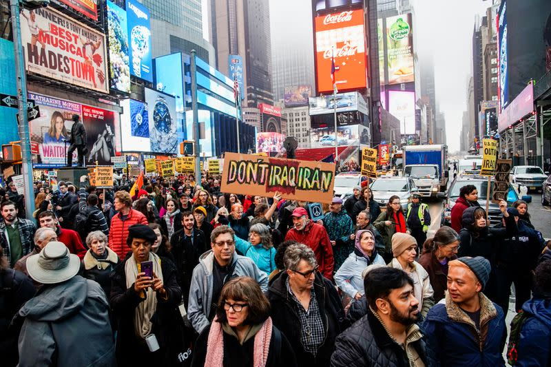 People take part in an anti-war protest amid increased tensions between the United States and Iran at Times Square in New York
