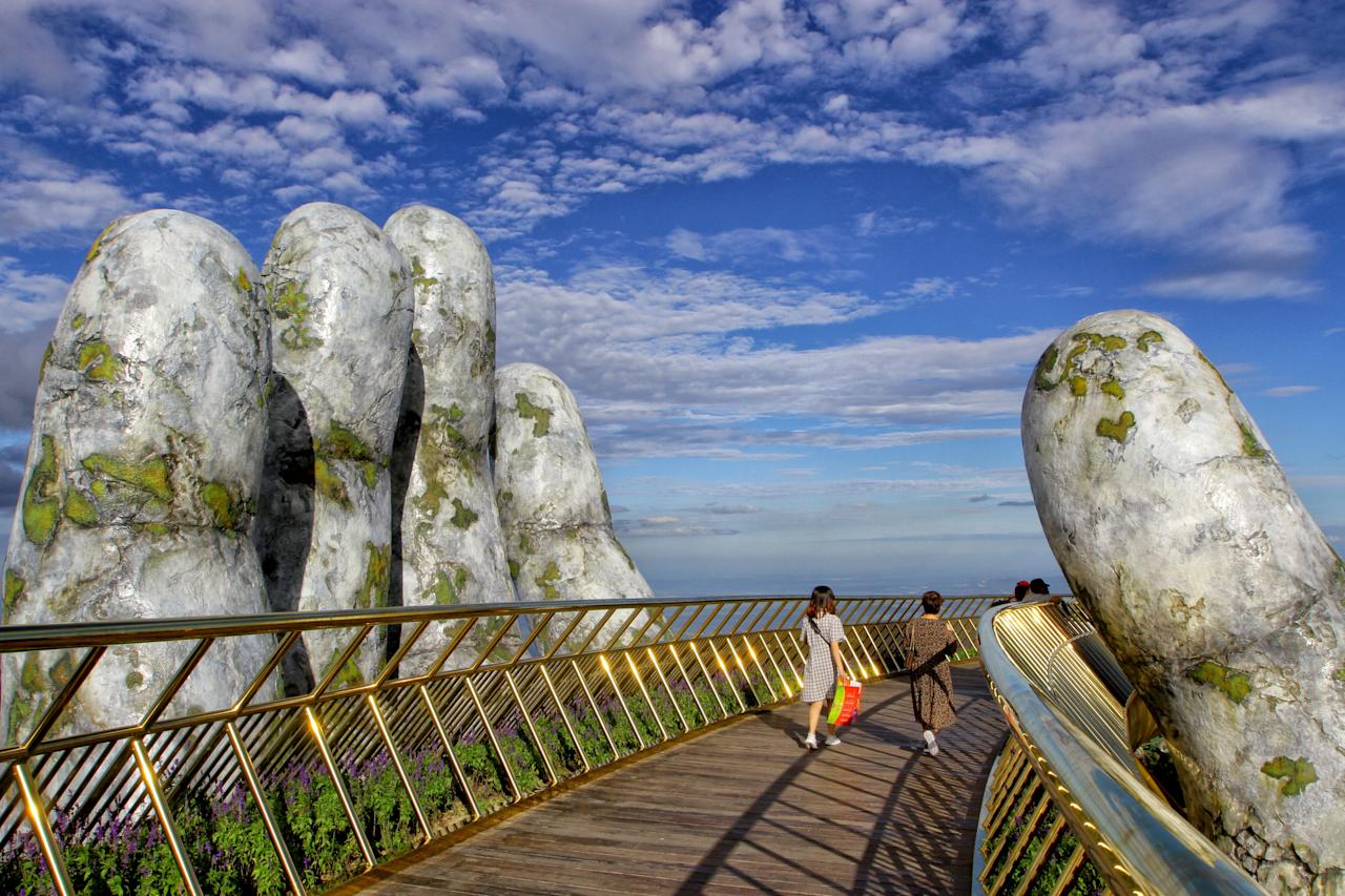 <p>Two giant concrete hands emerge from the trees, holding up the bridge. Photo: Getty </p>
