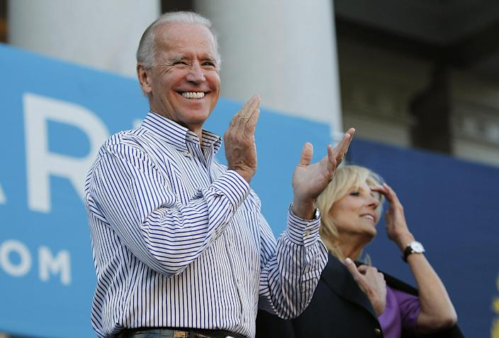 Vice President Joe Biden, with wife, Dr. Jill Biden, applauds on the steps of the State House in Concord, N.H., Friday, Sept. 21, 2012. (AP Photo/Cheryl Senter)