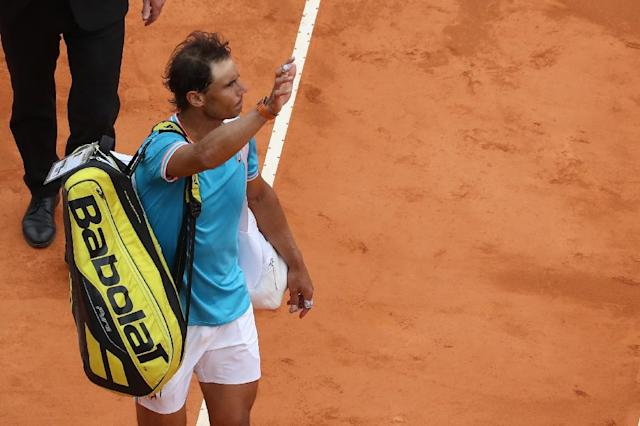 Shock loss: Rafael Nadal leaves the court after being defeated by Fabio Fognini (AFP Photo/VALERY HACHE)