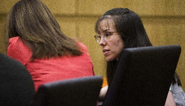 Jodi Arias asks a question of her attorney, Jennifer Willmott , left, while Judge Sherry Stephens, prosecutor Juan Martinez and defense attorneys Kirk Nurmi and Willmott  go over questions submitted by jurors in the murder trial of Jodi Arias, Wednesday March 6, 2013, in Maricopa County Superior Court in downtown Phoenix.  Arias is on trial for the murder of Travis Alexander in 2008. (AP Photo/The Arizona Republic, Tom Tingle, POOL)