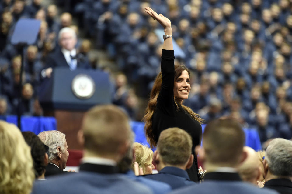 South Carolina state Rep. Nancy Mace, the first woman to graduate from The Citadel, smiles after being recognized by Vice President Mike Pence during a speech at the The Citadel, Thursday, Feb. 13, 2020, in Charleston, S.C. (AP Photo/Meg Kinnard