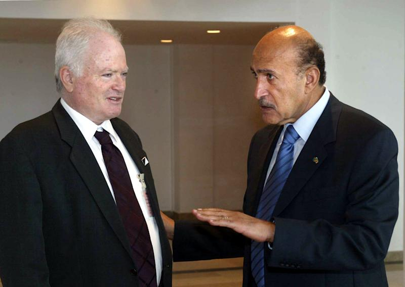 "FILE - In this Thursday, March 10, 2005 file photo, then-Chief of intelligence Omar Suleiman, right, of Egypt, talks to Amos Gilad, a top aide to Israeli Defense Minister Shaul Mofaz, following Egyptian President Hosni Mubarak meeting with Mofaz,  not pictured, at the Red sea resort of Sharm el-Sheik, Egypt. Israel's defense minister has repudiated remarks by a top official who called the Egyptian government a ""shocking dictatorship."" Ehud Barak issued a statement on Friday, Nov. 2, 2012 saying that the remarks by Defense Ministry official Amos Gilad do not reflect Israel's position. Gilad said there is no dialogue between Israel and the Egyptian leader and said he doesn't think there will be. (AP Photo, File)"