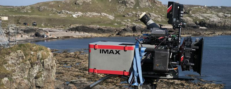 An IMAX laser camera filming in a rocky location.