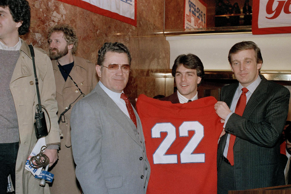 Donald Trump (right) made Heisman Trophy-winning quarterback Doug Flutie his centerpiece signing with the USFL's New Jersey Generals. (AP Photo/Marty Lederhandler)