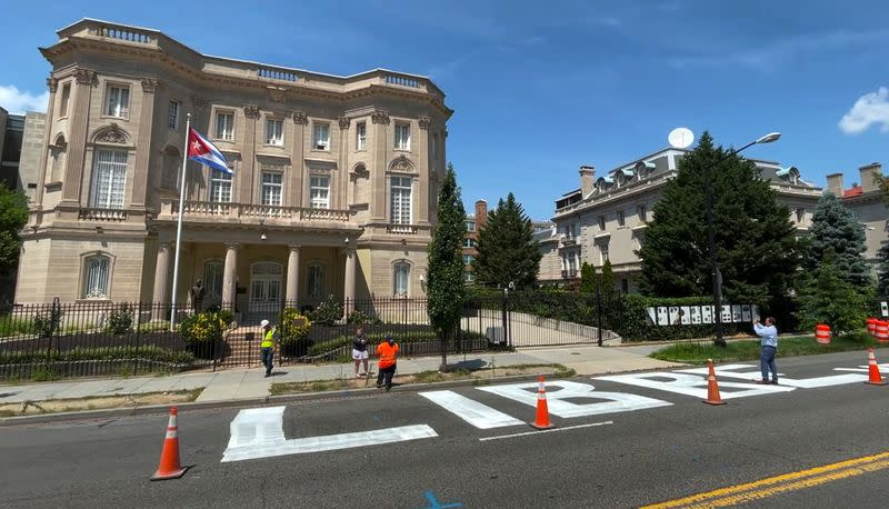 """Video grab shows message """"Cuba Libre"""" painted in giant block lettering in front of the Cuban embassy in Washington"""