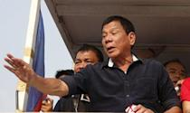 """Presidential candidate Rodrigo """"Digong"""" Duterte greets supporters during election campaigning for May 2016 national elections in Malabon, Metro Manila in the Philippines April 27, 2016. REUTERS/Erik De Castro"""