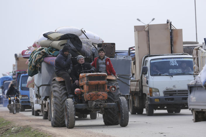 Syrian flee the advance of the government forces in the province of Idlib, Syria, towards the Turkish border, Wednesday, Jan. 29, 2020. Syrian government forces captured one of the largest and most strategic rebel-held towns in the country's northwest, the Syrian military and opposition activists said Wednesday, part of a Russian-backed military assault that has displaced hundreds of thousands of people fleeing to safer areas. (AP Photo/Ghaith Alsayed)