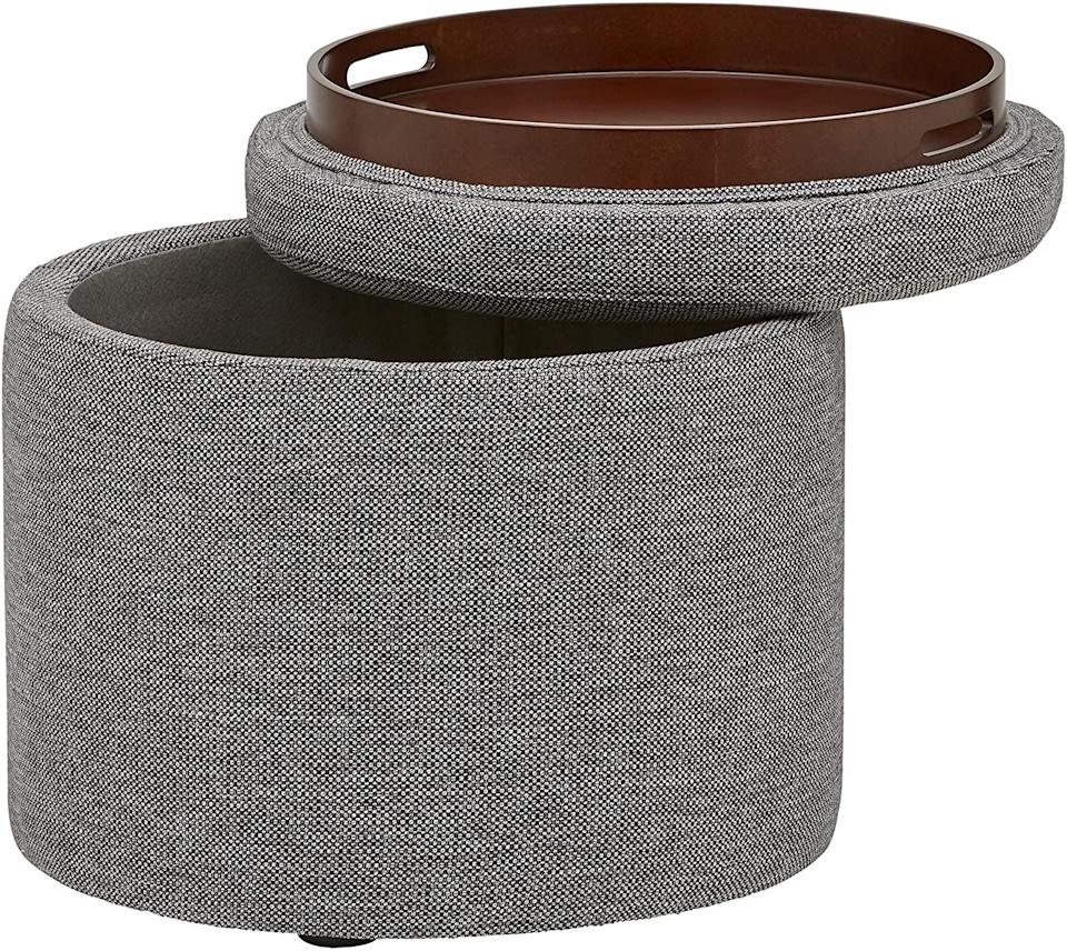 <p>You can't go wrong with this multifunctional <span>Amazon Brand Rivet Madison Modern Round Lift-Top Storage Tray Ottoman Pouf in Grey Storm</span> ($109). It's perfect for extra seating to accomodate guests, for storing extra blankets and clothes, and for whatever else you want. And if you turn over the lid, it's an extra tray for snacks.</p>