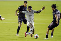Montreal forward Romell Quioto, center, controls the ball as Inter Miami midfielder Gregore, left, and midfielder Rodolfo Pizarro (10) defend during the first half of an MLS soccer match Wednesday, May 12, 2021, in Fort Lauderdale, Fla. (AP Photo/Lynne Sladky)