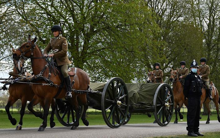 Members of the Kings Troop Royal Horse Artillery ride their horses into the grounds of Windsor Castle in Windsor, west of London, on April 15, - AFP