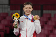 China's Chen Meng holds her gold medal as she poses for photographers in the table tennis women's singles at the 2020 Summer Olympics, Thursday, July 29, 2021, in Tokyo. (AP Photo/Kin Cheung)