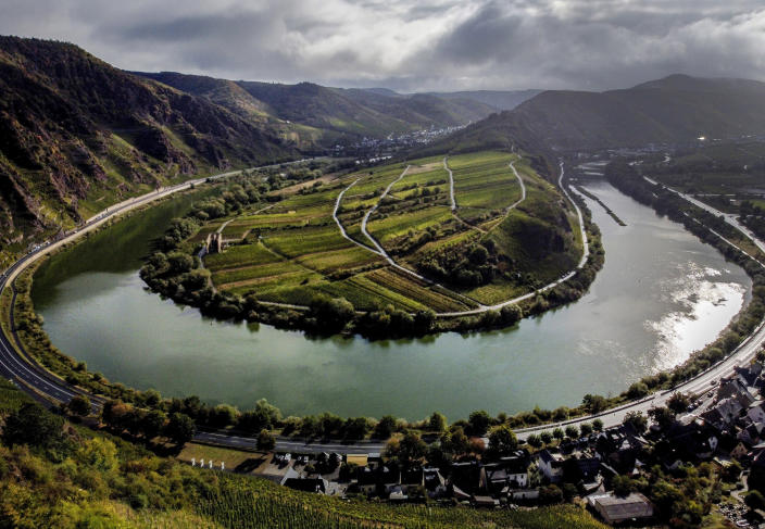 File---File picture taken Sept. 26, 2020 shows he Calmont vineyard standing over the Mosel loop in Bremm, Germany. The German disease control agency is adding France's Moselle region to its list of areas with a high rate of variant coronavirus cases, meaning travelers from there will face additional hurdles when crossing the border into neighboring Germany.(AP Photo/Michael Probst, file)
