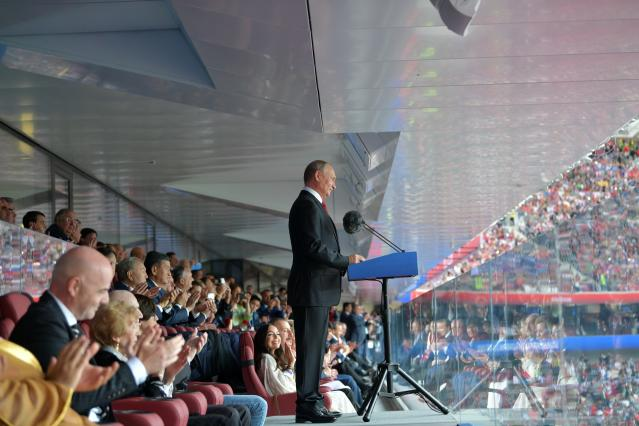 Russian President Vladimir Putin delivers his speech prior to the match between Russia and Saudi Arabia which opens the 2018 soccer World Cup as FIFA President Gianni Infantino, left, applauds at the Luzhniki stadium in Moscow, Russia, Thursday, June 14, 2018. (Alexei Druzhinin, Sputnik, Kremlin Pool Photo via AP)