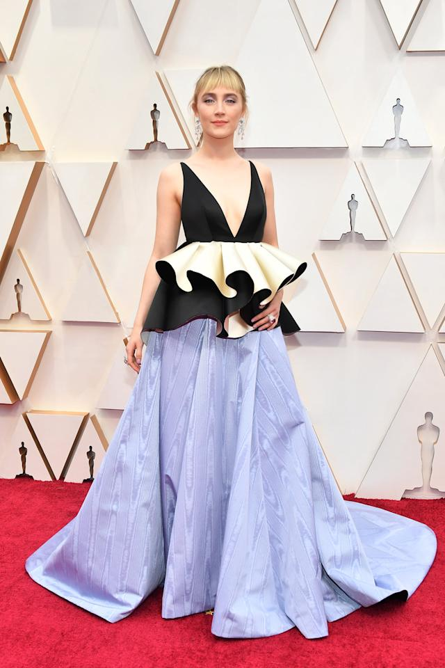 "<p>Wearing a <a href=""https://www.popsugar.com/fashion/saoirse-ronan-gown-at-oscars-2020-47196248"" class=""ga-track"" data-ga-category=""Related"" data-ga-label=""https://www.popsugar.com/fashion/saoirse-ronan-gown-at-oscars-2020-47196248"" data-ga-action=""In-Line Links"">beautiful low-cut Gucci dress with a lavender train</a>.</p>"