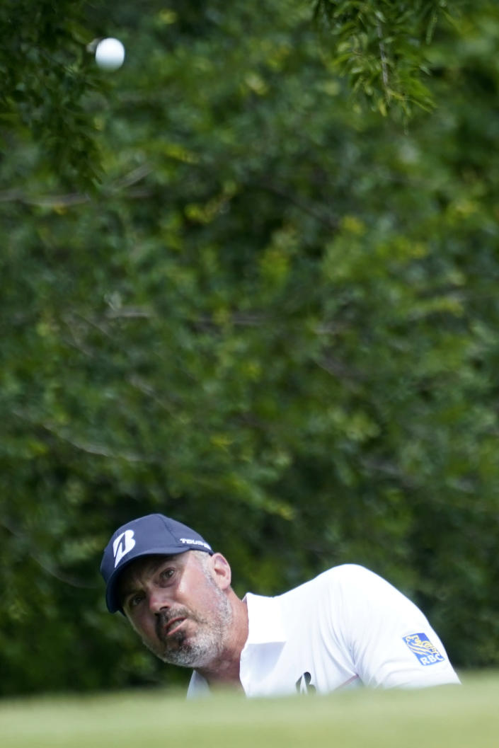 Matt Kuchar chips onto the first green during the third round of the AT&T Byron Nelson golf tournament, Saturday, May 15, 2021, in McKinney, Texas. (AP Photo/Tony Gutierrez)