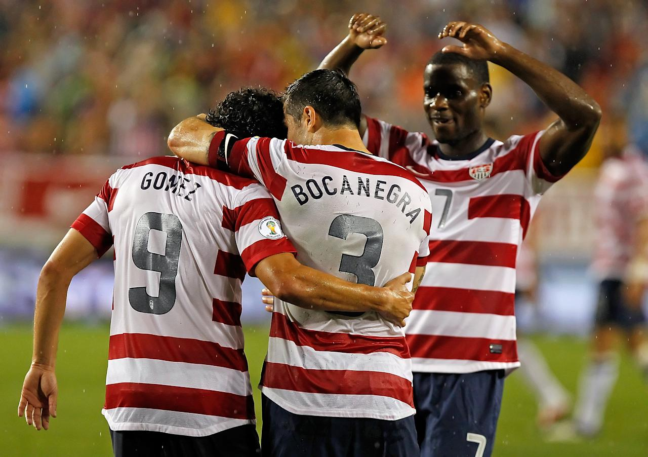 TAMPA, FL - JUNE 08:  Forward Herculez Gomez #9 of Team USA celebrates his goal with Carlos Bocanegra #3 and Maurice Edu #7 against Team Antigua and Barbuda during the FIFA World Cup Qualifier Match at Raymond James Stadium on June 8, 2012 in Tampa, Florida.  (Photo by J. Meric/Getty Images)