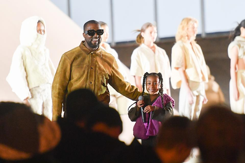 """PARIS, FRANCE - MARCH 02:  Kanye West and his daughter North West who sings on the runway during the """"Yeezy Season 8"""" show as part of the Paris Fashion Week Womenswear Fall/Winter 2020/2021 on March 02, 2020 in Paris, France. (Photo by Stephane Cardinale - Corbis/Corbis via Getty Images)"""