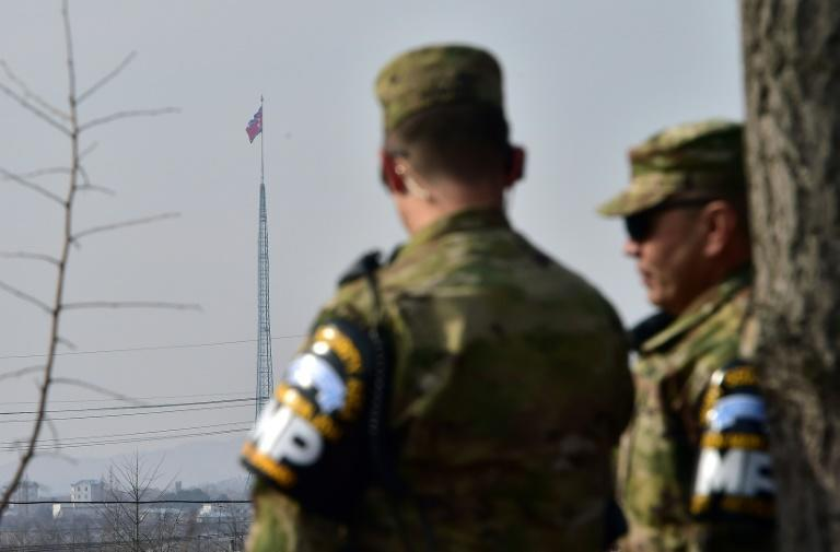 US soldiers stand guard at Taesungdong Elementary School in South Korea on February 4, 2016