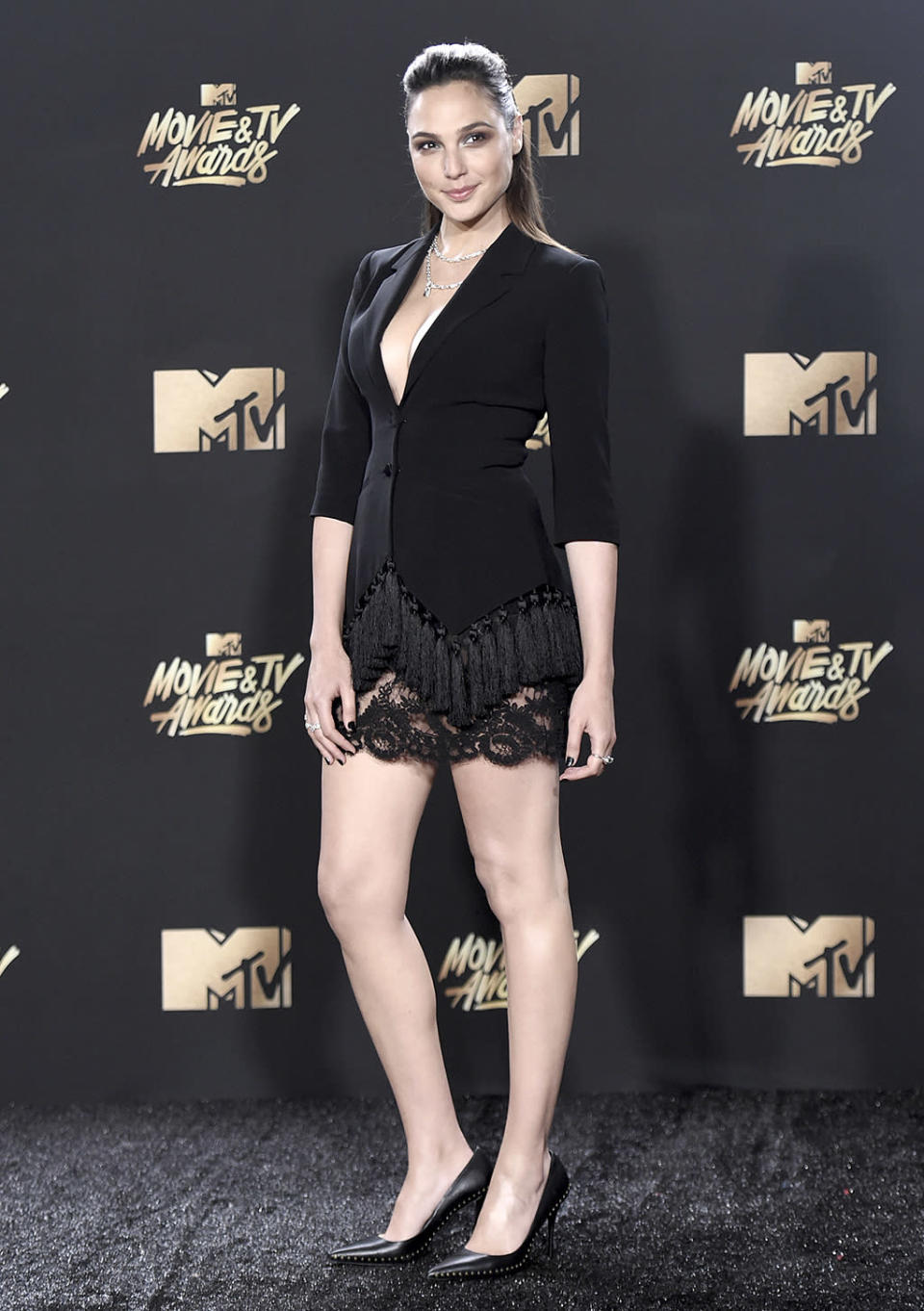 """<p>While Gadot is a fan of flats, she brought out the stilettos, pairing them with a tuxedo top and a lace skirt for last month's 2017 MTV Movie and TV Awards. She also <a rel=""""nofollow"""" href=""""https://www.yahoo.com/celebrity/wonder-woman-gal-gadot-brings-trailer-mtv-movie-014004457.html"""" data-ylk=""""slk:dropped the final trailer;outcm:mb_qualified_link;_E:mb_qualified_link;ct:story;"""" class=""""link rapid-noclick-resp yahoo-link"""">dropped the final trailer</a> for the much-anticipated <i>Wonder Woman</i>. (Photo: Richard Shotwell/Invision/AP) </p>"""