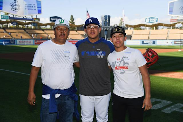The Urias family: Julio's father, Carlos (L), and brother, Carlos (R). (Photo courtesy Jon SooHoo/Los Angeles Dodgers)