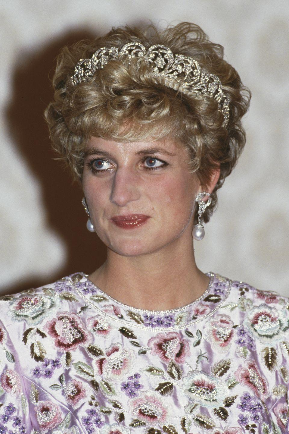 <p>At a state dinner in Seoul, South Korea with curled ends under her diamond tiara. </p>