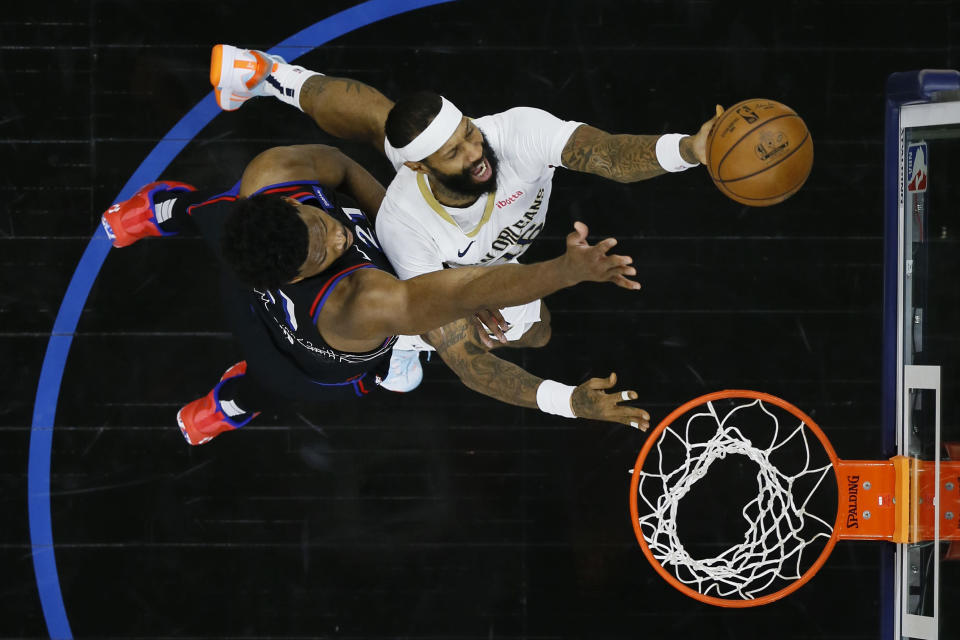 New Orleans Pelicans' James Johnson, right, goes up for a shot against Philadelphia 76ers' Joel Embiid during the second half of an NBA basketball game, Friday, May 7, 2021, in Philadelphia. (AP Photo/Matt Slocum)