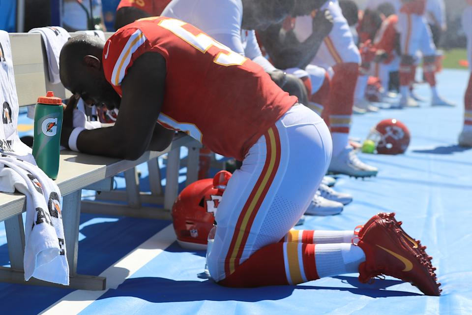 Justin Houston #50 of the Kansas City Chiefs is seen taking a knee during the National Anthem before the game against the Los Angeles Chargers at the StubHub Center on September 24, 2017 in Carson, California. (Photo by Sean M. Haffey/Getty Images)