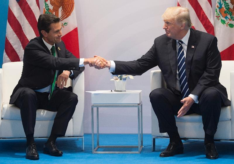 US President Donald Trump and Mexican President Enrique Pena Nieto shake hands during a meeting on the sidelines of the G20 Summit in Hamburg, Germany, in July, 2017, but tentative plans for a meeting in Washington have reportedly been shelved