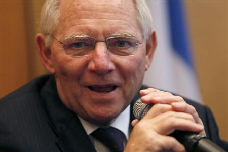 German's Finance Minister Schaeuble attends a news conference at the Bercy Finance Ministry in Paris