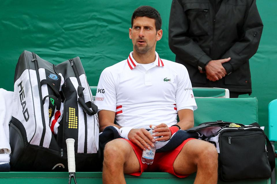 Novak Djokovic (pictured) sits between games during his third round singles match against Daniel Evans.