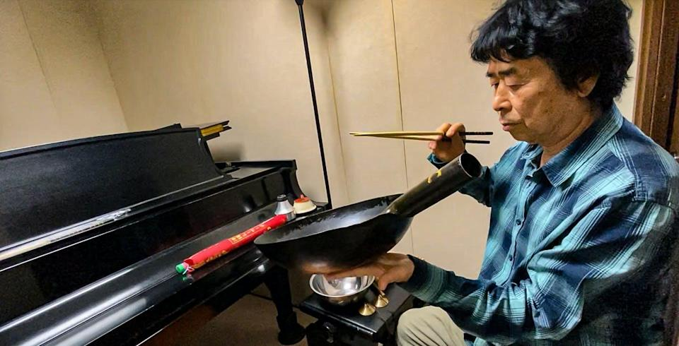"""<span class=""""caption"""">This is not a wok: Japanese musician Natsuki Tamura explores sounds at an online global festival of improvisation, IF 2020.</span> <span class=""""attribution""""><span class=""""source"""">(Ajay Heble/IF 2020)</span>, <span class=""""license"""">Author provided</span></span>"""