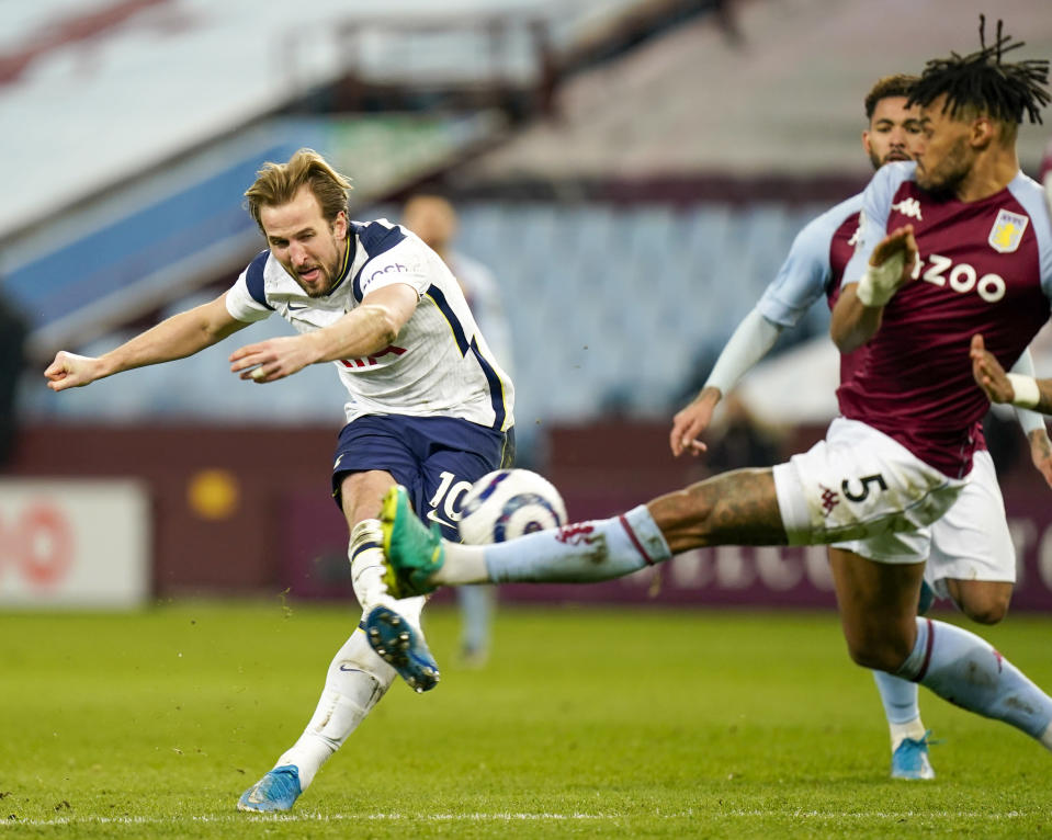 Tottenham's Harry Kane, left, takes a shot at goal as Aston Villa's Tyrone Mings attempts to block 131during the English Premier League soccer match between Aston Villa and Tottenham Hotspur at Villa Park in Birmingham, England, Sunday, March 21, 2021. (AP Photo/Tim Keeton,Pool)