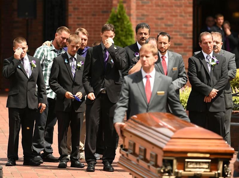 Relatives, including Shan'ann Watts' father and brother, mourn during the funeral for her and her daughters