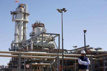 A technician stands at the Krechba gas treatment plant