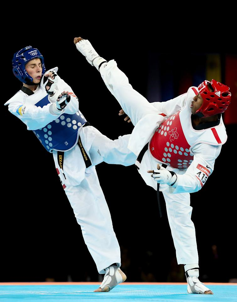 LONDON, ENGLAND - AUGUST 09:  Terrence Jennings (R) of the United States competes against Hryhorii Husarov (L) of Ukraine during the Men's-68kg Taekwondo repechage on Day 13 of the London 2012 Olympic Games at ExCeL on August 9, 2012 in London, England.  (Photo by Scott Heavey/Getty Images)