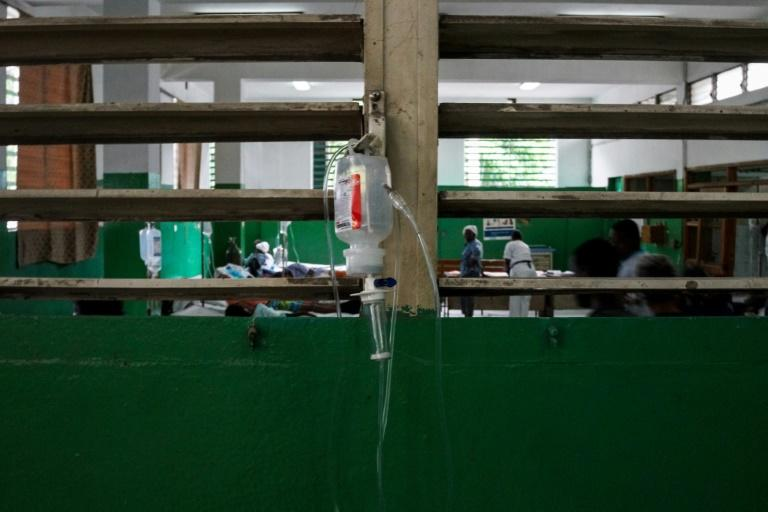 A glucose bottle is seen hanging on a window latch of the intensive care unit during the doctors' strike