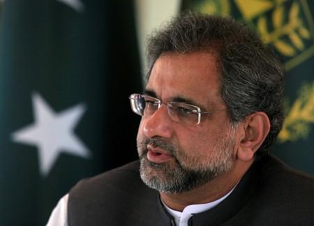 FILE PHOTO: Pakistan's Prime Minister Abbasi speaks with a Reuters correspondent during an interview at his office in Islamabad