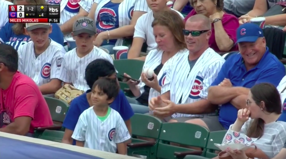 The internet branded this guy a villain for appearing to steal a baseball from a kid, but there's more to the story than the video showed. (Screengrab via MLB)